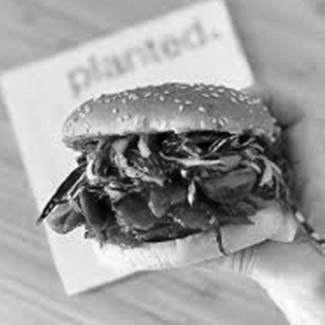 a burger and the planted logo